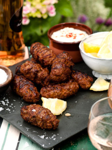 Homemade sausages with spiced mint yogurt recipe