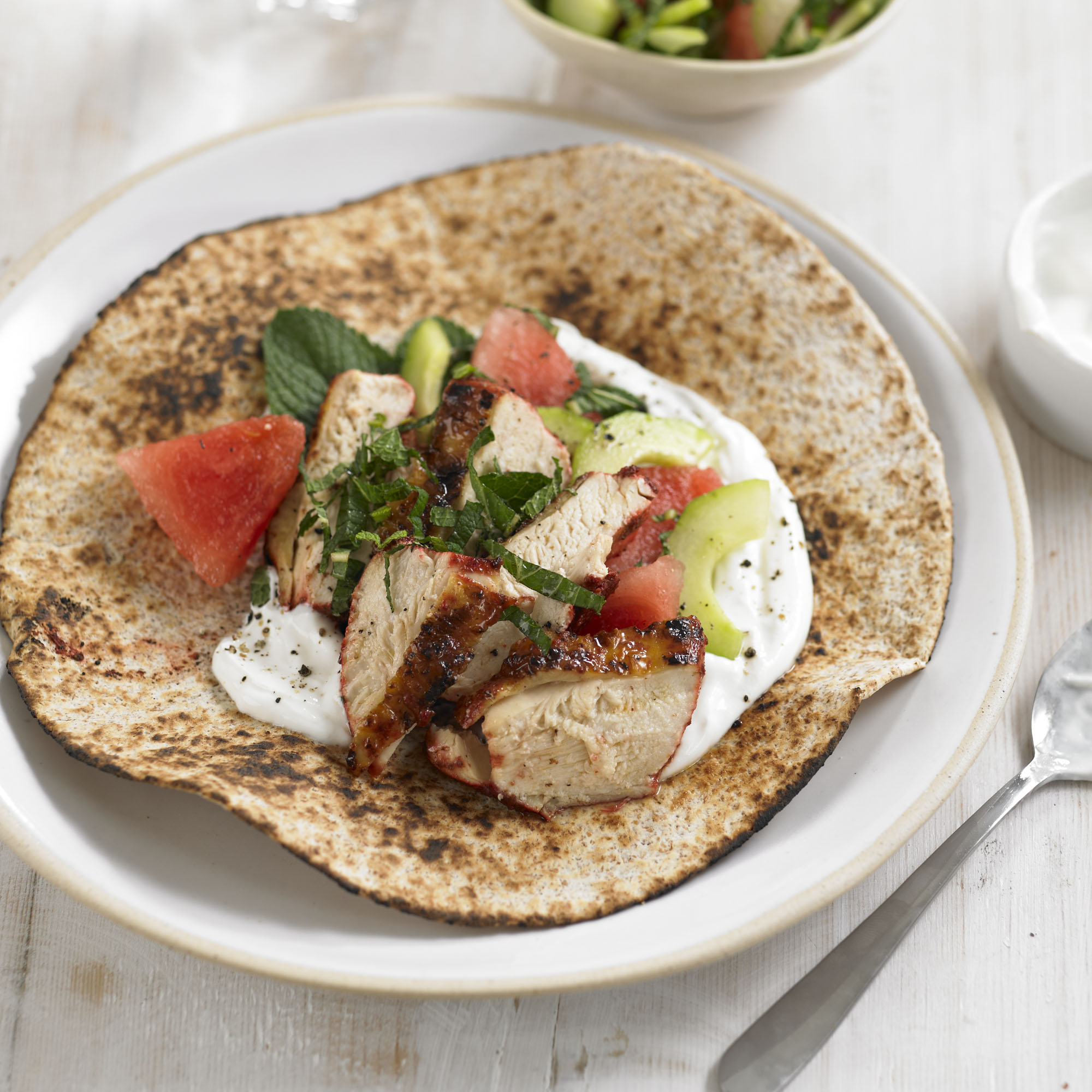 Tandoori chicken flatbreads with watermelon and mint salad recipe