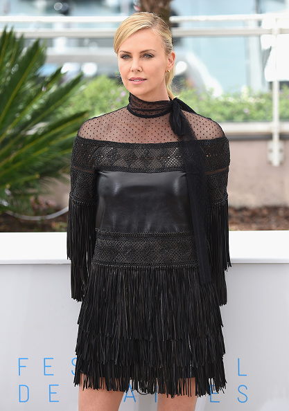 "CANNES, FRANCE - MAY 14:  Charlize Theron attends the ""Mad Max : Fury Road""  Photocall during the 68th annual Cannes Film Festival on May 14, 2015 in Cannes, France.  (Photo by Venturelli/WireImage)"