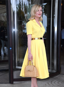 For the jury photo-call, Kirsten Dunst wore a yellow dress with metal belt by Dior Haute Couture.