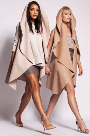 Eco leather pencil skirt, R1 250; Cream wool cape, R2 200; Camel cashmere cape, R2 600