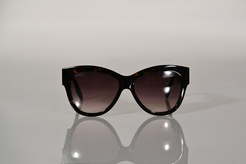 Sunglasses: Tortoiseshell with gold eyelets, from 5 875, MCQ by Alexander McQueen at SDM Eyewear