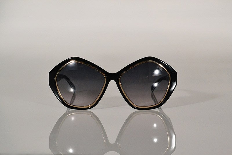 Sunglasses: Geometric black and gold, from R3 975, Emilio Pucci at SDM Eyewear