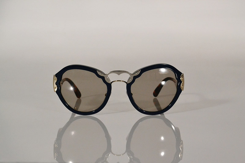 Sunglasses: Navy, silver and tortoiseshell, R5 090, Prada at Sunglass Hut