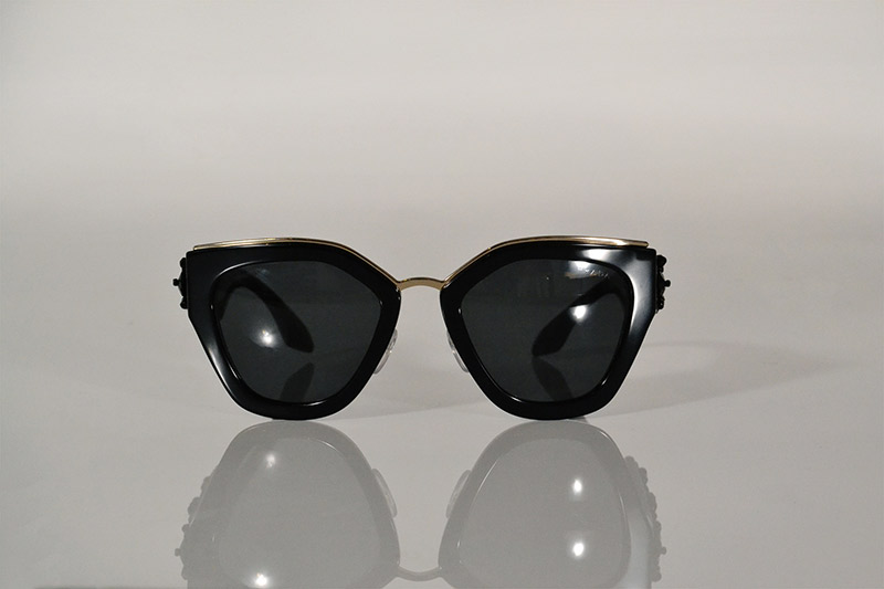 Sunglasses: Black and gold with beaded arms, R8 790, Prada at Sunglass Hut