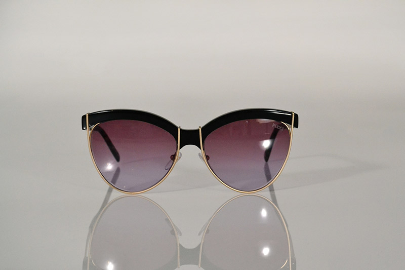 Sunglasses: Gold and black cat eye, from R3 975, Emilio Pucci at SDM Eyewear