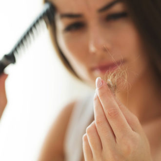 Common Hair Loss Causes, Plus How To Treat Them