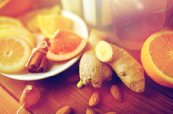 ginger, citrus fruits, tea or honey on wood