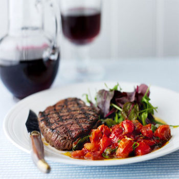plate of steak and tomatoes