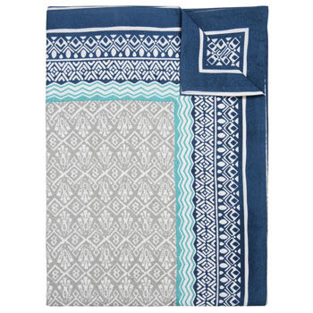 folded blue and white tablecloth