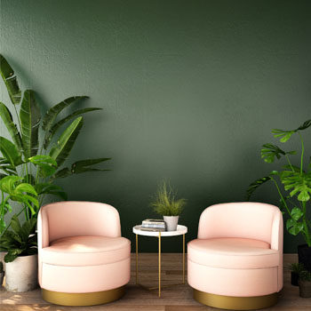 coral chairs against green wall