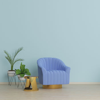 blue chair against mint wall