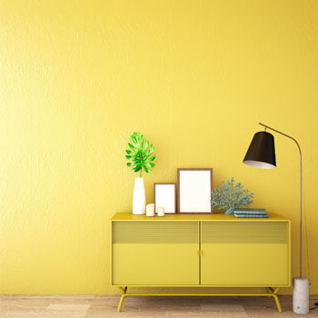 yellow dresser against yellow wall