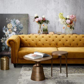 gold couch in lounge