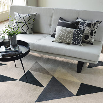 carpet and cushions with geometric shapes